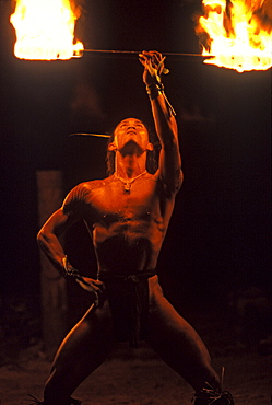 Traditional dancer with fire torch for tourists at Tiki Village,Moorea French Polynesia