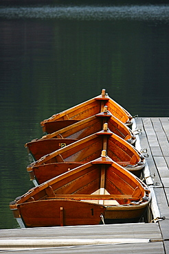 Four boats tied to the dock on Lake Mohonk, wait to be rowed.