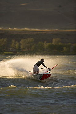 Jason Russ lays a big spray up into the last bits of light on the Columbia River