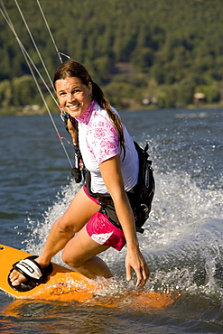 Renee Hanks makes the most of a sunny windy day in the Gorge, Kiteboarding the Columbia River Gorge.