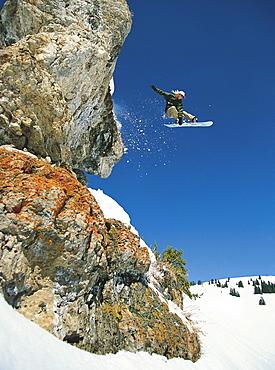 Joe Curtes jumps a cliff in Vail Colorado's Back Bowls