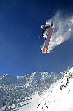 Young Snowboarder (Steve Whelan) catches big air at Fernie Alpine Resort, Fernie, East Kootenays, British Columbia, Canada.