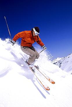 Jenn Berg catches air while skiing in Snowbird, Utah.