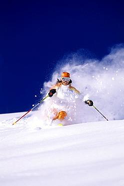 Suzanne Montgomery sking powder at Snowbird resort in Snowbird, Utah.