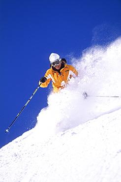 Heather Walker sking powder at Snowbird resort in Snowbird, Utah.