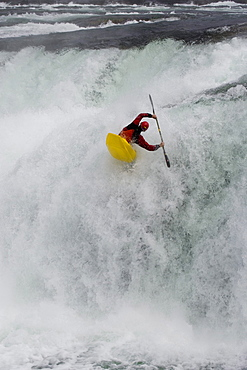 "Young man (Trip Jennings) performs ""freewheel"" move over Kootenai Falls on Kootenai River near Libby, Montana"