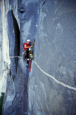 Bob Porter makes his way up Zodiac, a 16 pitch 5.11 A3+ route on El Capitan in Yosemite National Park, California.