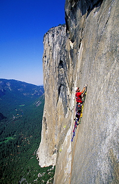 Bob Porter places a cam on Zodiac, a 16 pitch 5.11 A3+, route on El Capitan in Yosemite National Park, California.