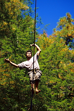 Bart Bledsoe walks a 100ft long and 200 foot high slackline set up at Torrent Falls near Slade, KY.