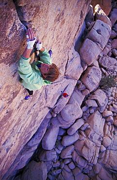 Rock climber Rikke Ishoy makes her way up a thin crack climb in Joshua Tree National Park, California.