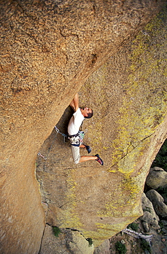 """Justin Bastien lead climbs an overhanging 5.11 climbing route at the Vedauwoo climbing area in Medicine Bow National Forest, Wyoming. Vedauwoo is believed to mean """"Land of the Earthborn Spirits"""" in Arapahoe."""