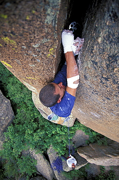 """Justin Bastien places a cam in a crack on a 5.12 climbing route in the Vedauwoo climbing area in Medicine Bow National Forest, Wyoming. Vedauwoo is believed to mean """"Land of the Earthborn Spirits"""" in Arapahoe."""