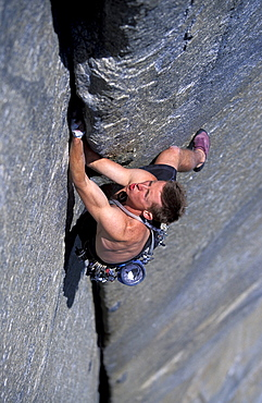 Rock climber Tommy Caldwell jams his hands into a crack on while lead climbing the the West Buttress climbing route of El Cap in Yosemite Valley, California.Tommy Caldwell is one of the world's leading big wall rock climbers.