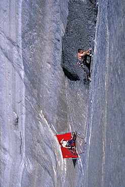 Beth Rodden belays her husband, big wall climber Tommy Caldwell, from a portalege as Caldwell is rock climbing Dihedral wall, a multi pitch route on El Capitan in Yosemite National Park, California.