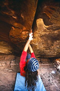 Zoe Hart bouldering at the Crack House, Moab, Utah.