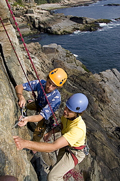 Rock Climbing on oceanside cliffs in Acadia Nation Park from a professional instructor.