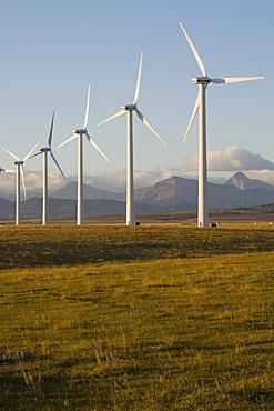 Windmills used for power generation at sunrise, near Pincher Creek, Alberta, Canada.