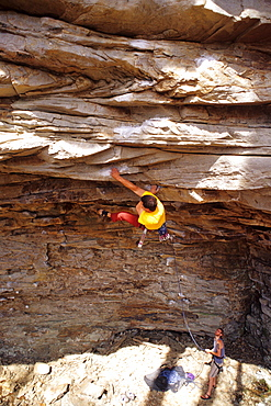 Male climber on steep sandstone in Little River Canyon, Alabama.