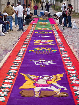 As part of the observance of Lent in Guatemala, a group of people prepares an aromatic carpet for a procession in Antigua, Guate