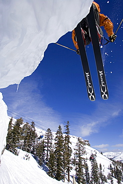 A skier jumps off of a cliff in Kirkwood, California.