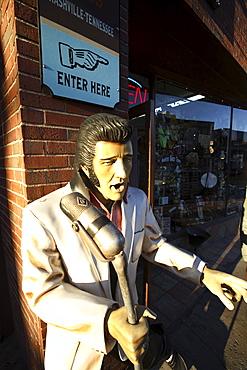 A statue of Elvis Presley on the sidewalk along Lower Broadway in Nashville, TN