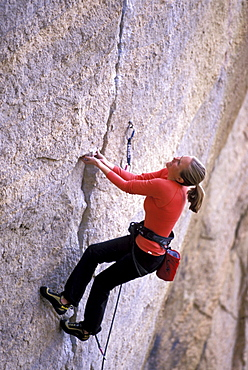 A woman lead climbing in Bend, Oregon.