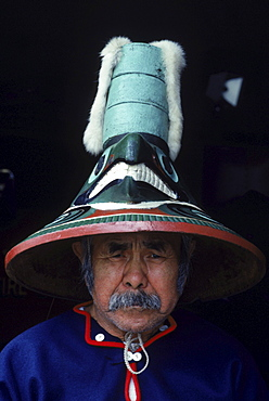 Tlingit Indian with a decortaive hat.