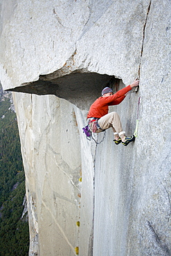 Male free climbing