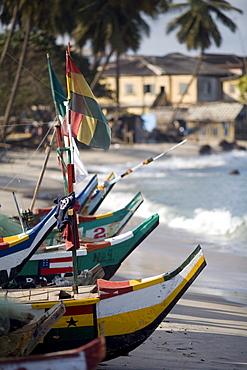 Row of boats on the beach in Elmina