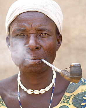 Wife of the local chief smokes a pipe