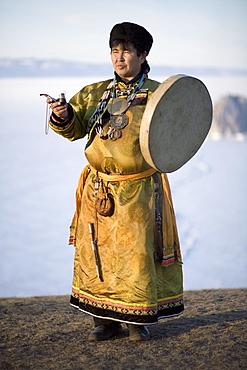 A Shaman performs a ceremonial ritual on Olkhon Island, Siberia, Russia.