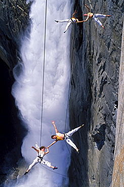 Suspended from wires 2,500 vertical feet up a cliffside in Yosemite National Park, the Bandaloop Troupe performs an air dance next to Yosemite Falls.