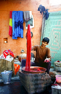 In the backstreets of Bikaner you will find many fabric dyers, they dye in steaming hot metal pots and every color is available. Bikaner, Rajahstan, India 2007.