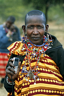 Masai woman with her cell phone.