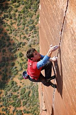 A man rock climbing in Zion National Park, UT.