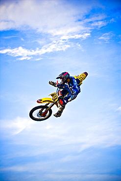 A motocross biker performs a stunt in the sky in Brainerd, Minnesota.