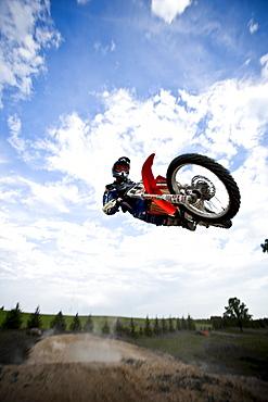 A motocross biker shows off a horizontal stunt during a jump in Brainerd, Minnesota.