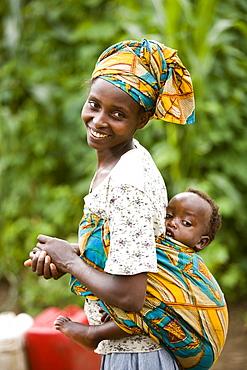 Rwandan woman carrying her child on her back.