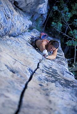Jeff Jackson climbing Radio Mexixo 5.10, a crack outside of Guadalajara, Mexico.