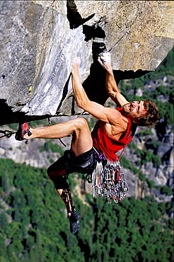 Tim O'Neil climbing on Rostrum 5.12 in Yosemite National Park, California.