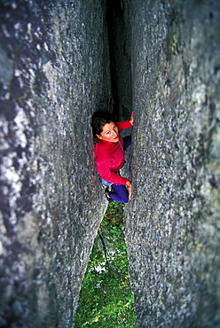 Sue McDevitt climbing Generator Crack 5.10 in Yosemite National Park, California.