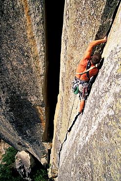 Justin Bastien climbing Anticipation 5.11b on Arch Rock in Yosemite National Park, California.