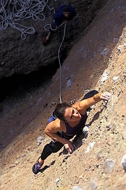 Sabina Allemann climbing Subterranean Tango 5.11 in the Pinnacles in California.