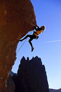 Nancy Prichard climbing Chain Reaction 5.12c at Smith Rock near Bend, Oregon.