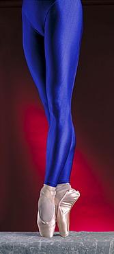 Ballerina's legs on pointe.