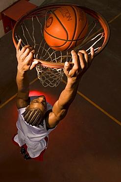 Clark College basketball player Markeith Brown slam dunks ball in Portland, Oregon.
