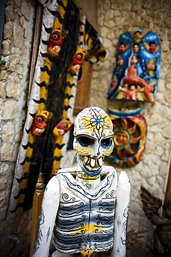 A painted carved  skeleton is on display in Playa del Carmen, Mexico.