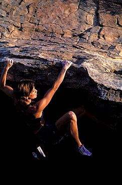 Rikke Ishoy bouldering on an overhang in Santa Barbara, California.