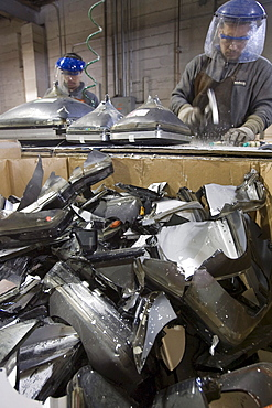 At ElectroniCycle, a recycling company in Gardner, Massachusetts CRT monitors are being broken to be recycled for glass-to-glass recycling.