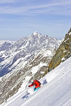A man skis untracked powder off-piste at Stubai Ski Resort, near Innsbruck, Austria.